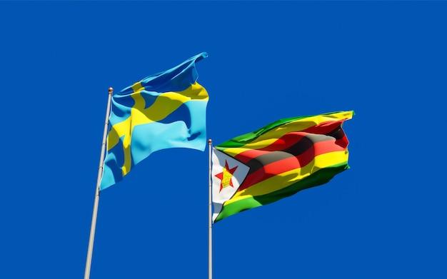 Nahaufnahme auf flaggen von simbabwe und schweden
