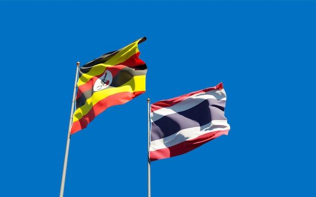 Nahaufnahme auf flaggen von uganda und thailand