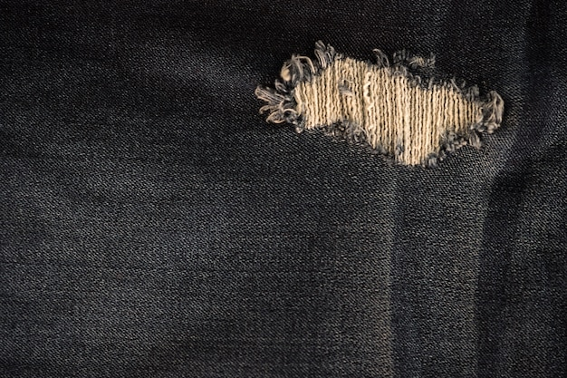 Nahaufnahme der denimbeschaffenheit von denim jeans und stich für weinlese