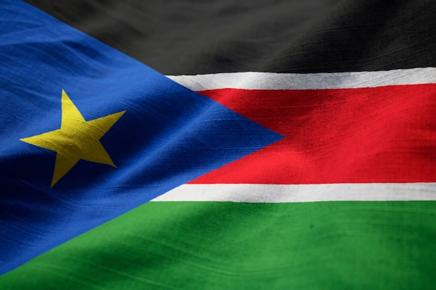 Nahaufnahme der gekräuselten sudan-südmarkierungsfahne, sudan-südmarkierungsfahne, die im wind durchbrennt