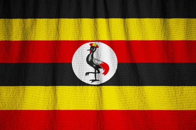Nahaufnahme der gekräuselten uganda-flagge, uganda-flagge, die im wind durchbrennt