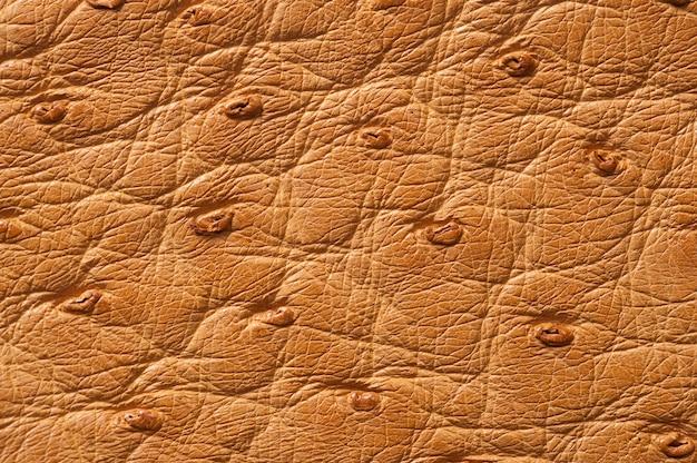 Nahaufnahme der nahtlosen beige lederbeschaffenheit für hintergrund