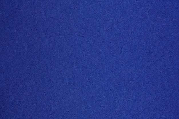 Nahaufnahme der nahtlosen dunkelblauen papierstruktur für hintergrund oder kunstwerke