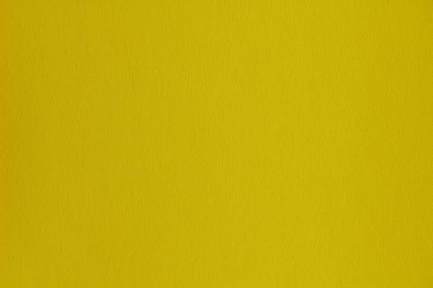 Nahaufnahme der nahtlosen gelben papierstruktur für hintergrund oder kunstwerke