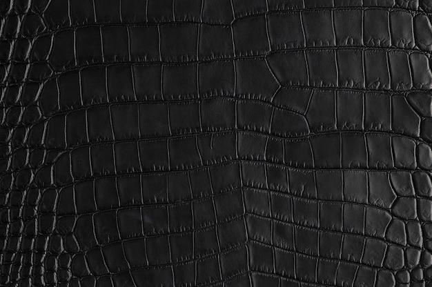Nahaufnahme der nahtlosen krokodilschwarzen lederbeschaffenheit
