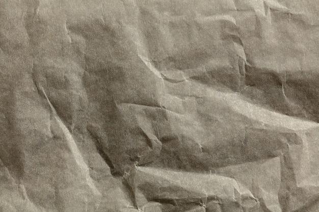 Nahaufnahme der oberfläche der zerknitterten papierstruktur