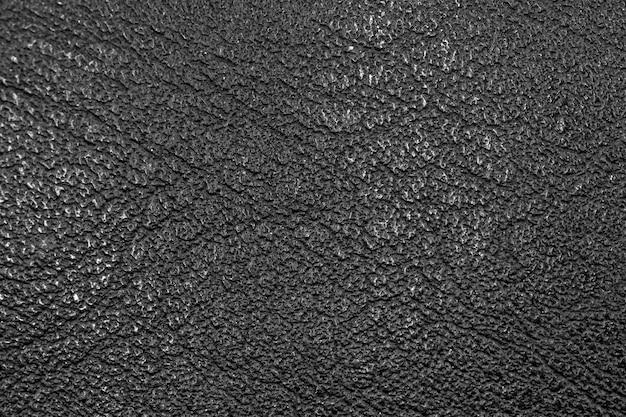 Nahaufnahme der schwarzen lederstruktur auf einer tasche, hohe detailgenauigkeit und auflösung der oberfläche