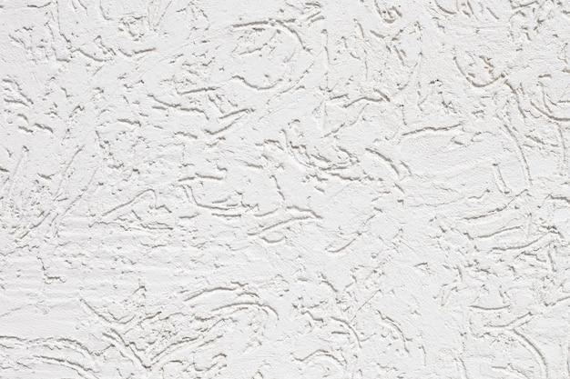 Nahaufnahme der weißen rissigen wand der textur