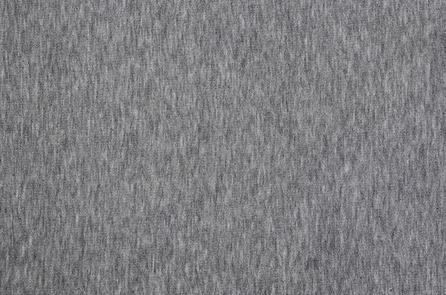 Nahaufnahme der zerknitterten heizung und des gestrickten strukturierten stoffhintergrundes des jersey- oder hoodiegewebes mit empfindlichem gestreiftem muster