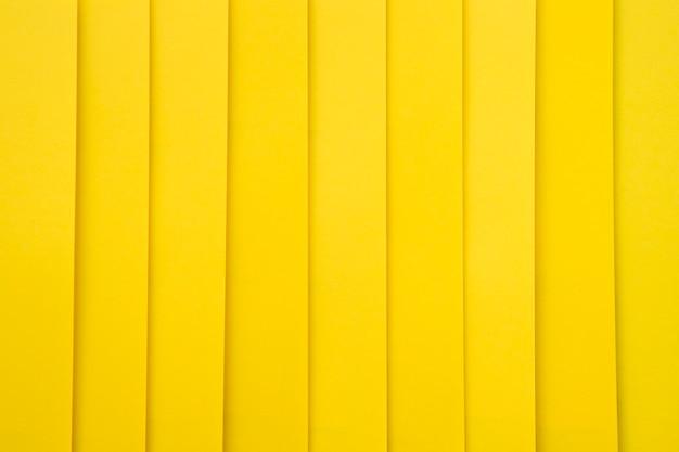 Nahaufnahme des gelben pappbeschaffenheitshintergrundes