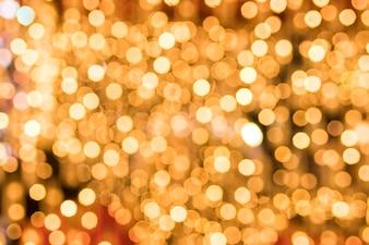 Nahaufnahme des glühenden goldenen bokeh Hintergrundes