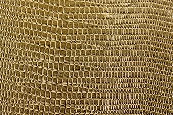 Nahaufnahme des goldenen schuppigen strukturierten Musterhintergrundes