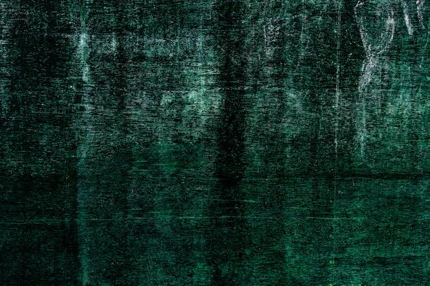 Nahaufnahme des grünen holzbretts mit zerkratztem und schmutz. abstrakter texturhintergrund.