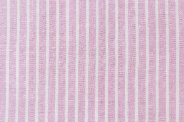 Nahaufnahme des rosa stoffbeschaffenheitshintergrundes