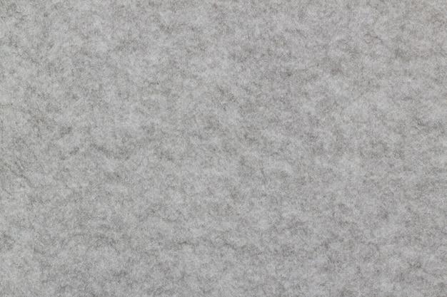 Nahaufnahme des schallschutzbrettes, graue wand, zum der geräusche zu verringern gemacht von glasswool