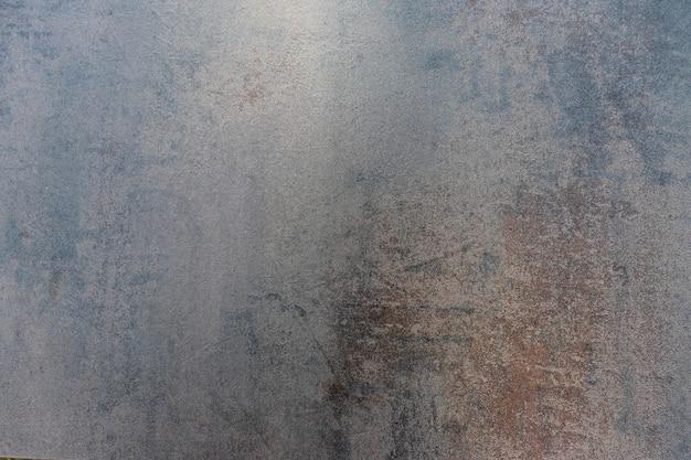 Nahaufnahme des strukturierten hintergrundes des dunklen schmutzes