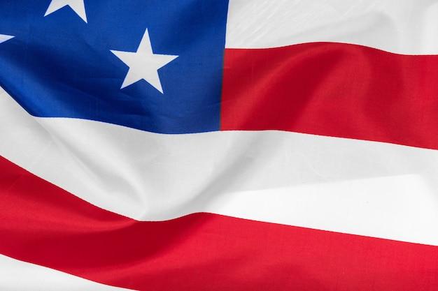Nahaufnahme des wellenartig bewegens des hintergrundes der amerikanischen flagge