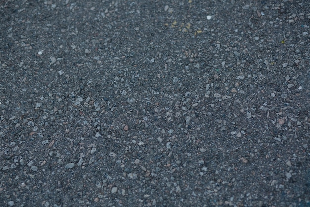 Nahaufnahme einer dunkelgrauen asphaltbeschaffenheit