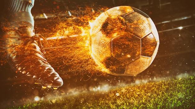 Nahaufnahme einer fußballszene bei nachtspiel mit einem fußballschuh, der einen feurigen ball mit kraft tritt