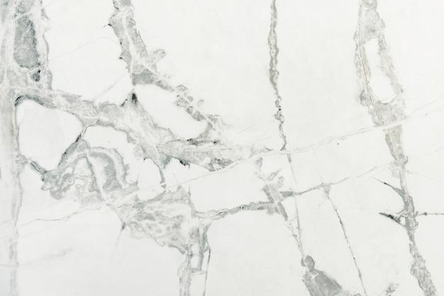 Nahaufnahme einer strukturierten wand aus weißem marmor