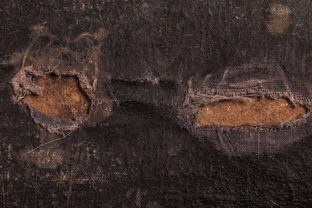 Nahaufnahme eines alten leinwandkoffers, weinleseblick