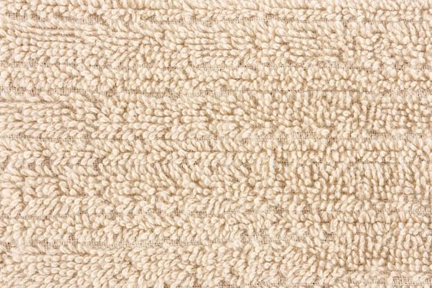 Nahaufnahme eines hellbraunen tuches. textile details hintergrund.