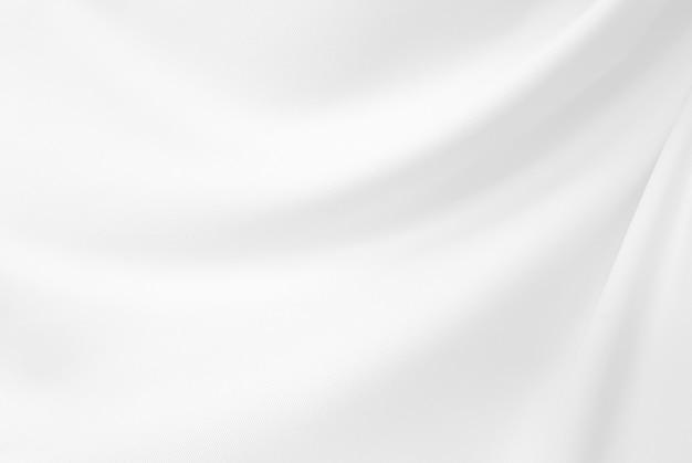 Nahaufnahme elegant zerknittert vom weißen seidengewebestoff und -beschaffenheit.