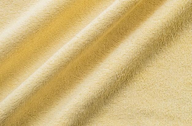 Nahaufnahme geknitterter gelber serviettengewebehintergrund