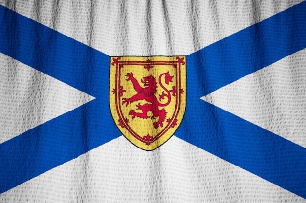Nahaufnahme gekräuselter neuschottland-flagge, neuschottland-flagge, die im wind durchbrennt