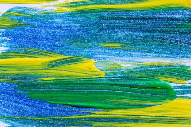 Nahaufnahme geschossen von der bunten acrylfarbe der pinselstriche auf segeltuch