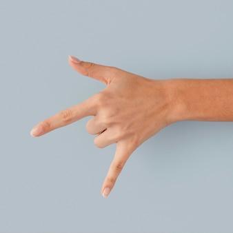 Nahaufnahme hand, die telefonzeichen macht