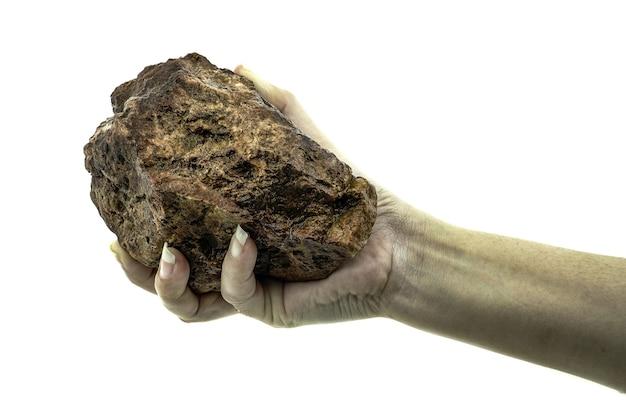 Nahaufnahme hand hält stein isoliert auf weißem hintergrund