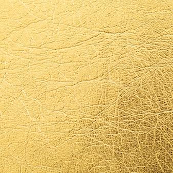 Nahaufnahme schuss des goldenen ledertexturhintergrundes