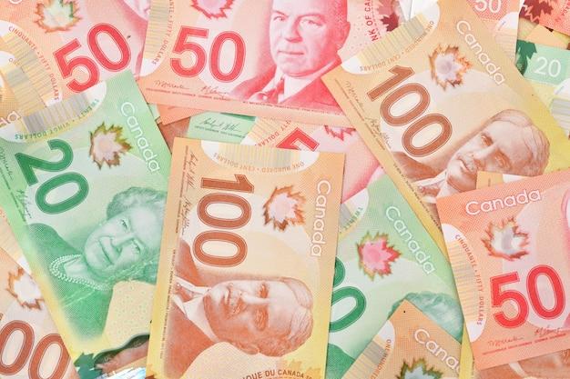 Nahaufnahme schuss von kanadischen dollar banknoten raum, konzept von geschäft und finanzen.