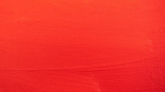 Nahaufnahme textur rote farbe auf leinwand pinselstriche für papiergrafikdesign auf hintergrund