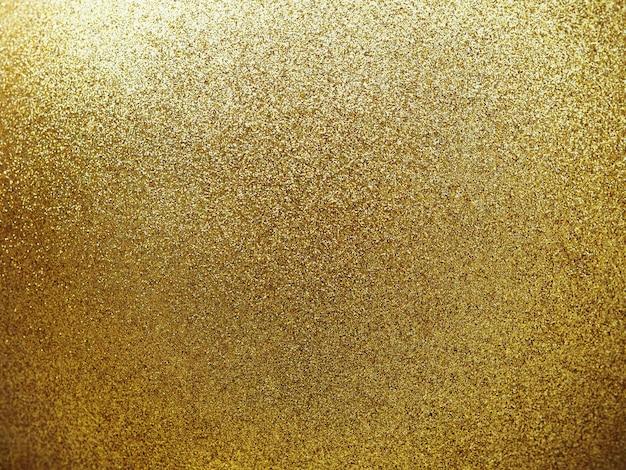 Nahaufnahme texturiert von goldener runder kugel mit glitzer.
