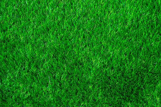 Nahaufnahme von grünem kunstrasen für den hintergrund