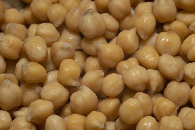 Nahaufnahmeaufnahme der gekochten kichererbsen-hohen proteinsamen