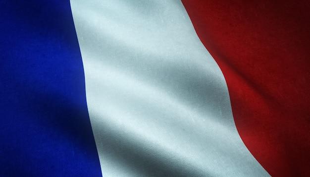 Nahaufnahmeaufnahme der wehenden flagge von frankreich mit interessanten texturen