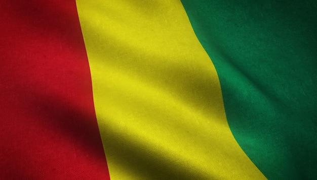 Nahaufnahmeaufnahme der wehenden flagge von guinea mit interessanten texturen
