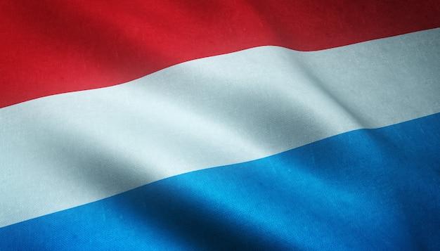 Nahaufnahmeaufnahme der wehenden flagge von luxemburg mit interessanten texturen