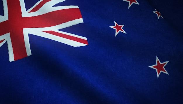 Nahaufnahmeaufnahme der wehenden flagge von neuseeland mit interessanten texturen