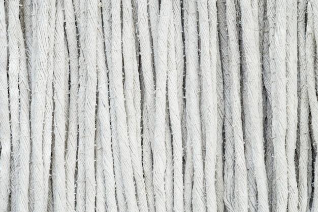 Nahaufnahmeflächengewebe am alten moppbeschaffenheitshintergrund