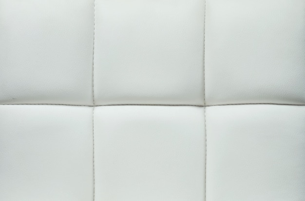 Nahaufnahmeoberfläche des grauen leders der sofabeschaffenheit