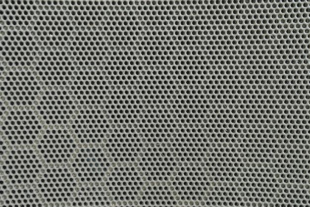 Nahaufnahmeoberfläche des schwarzen metalllautsprechers an der tür des strukturierten hintergrundes des autos