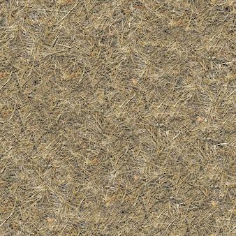 Nahtlose bodentextur bedeckt mit verwelktem gras.