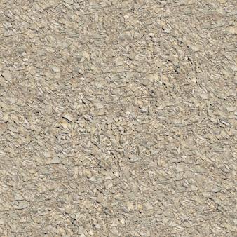 Nahtlose kippbare textur der leichten makadamoberfläche.