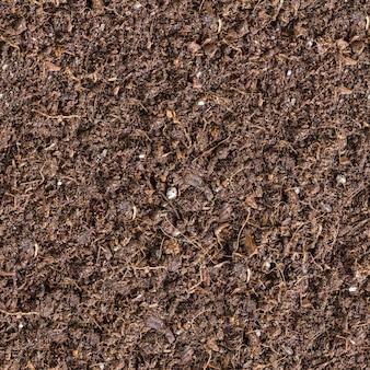 Nahtlose kippbare textur des braunen bodens.