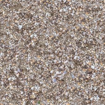 Nahtlose textur des fragmentbodens gemischt mit kies, schotter, stücken coquina und glas.