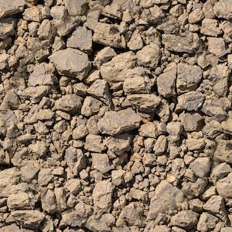 Nahtlose textur - trockener fragmentierter sandstein- oder lehmboden